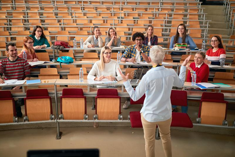 Professor Holding Lecture to a Multi Ethnic Group of Students. Young People Studying at the University royalty free stock images
