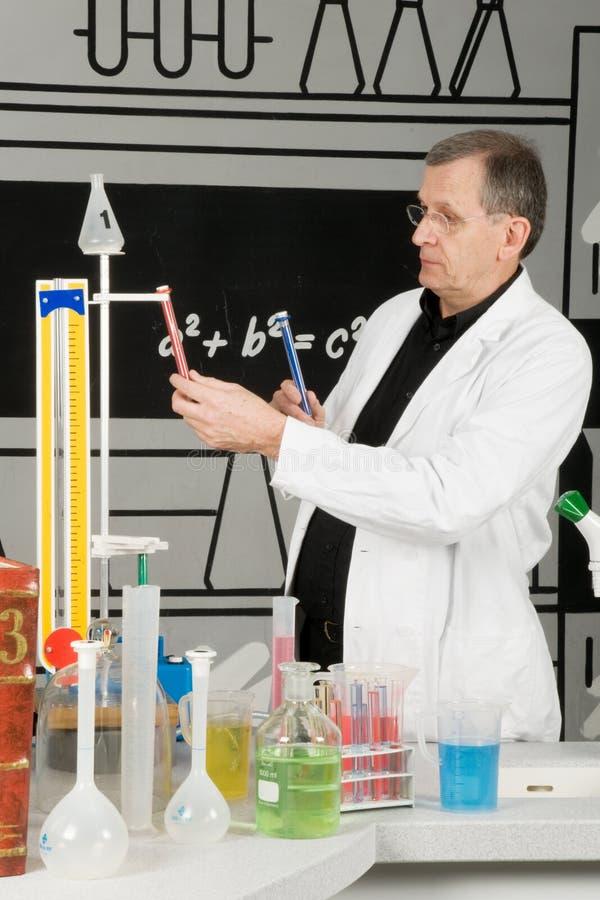Professor in the laboratory. Serious professor in the laboratory stock photos