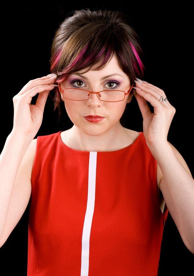 Professor novo em um vestido vermelho imagens de stock royalty free