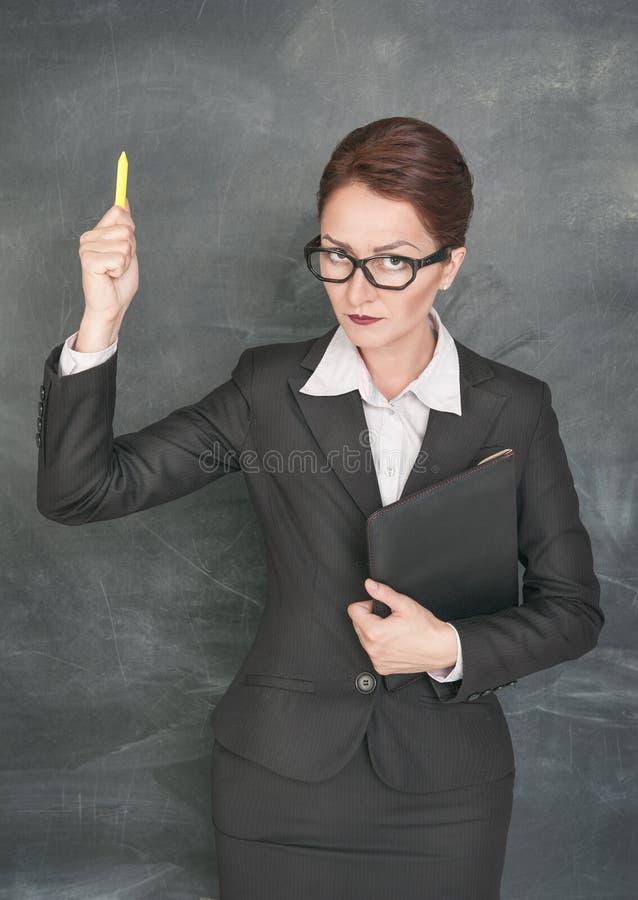Professor restrito com giz e dobrador foto de stock royalty free
