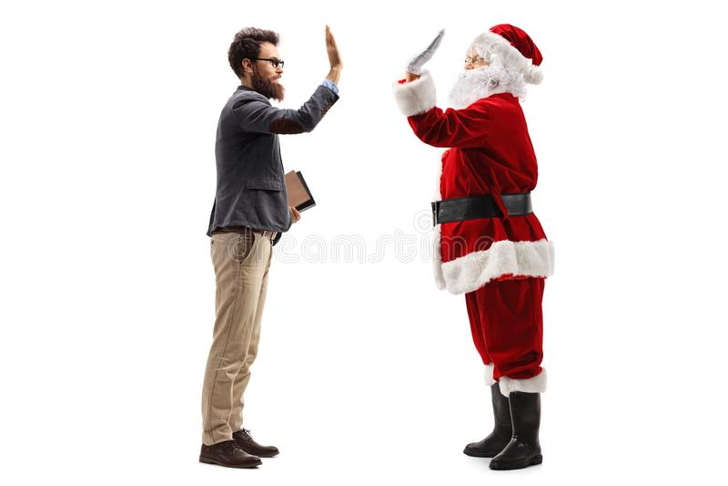 Professor Santa Claus alta-fiving imagem de stock royalty free