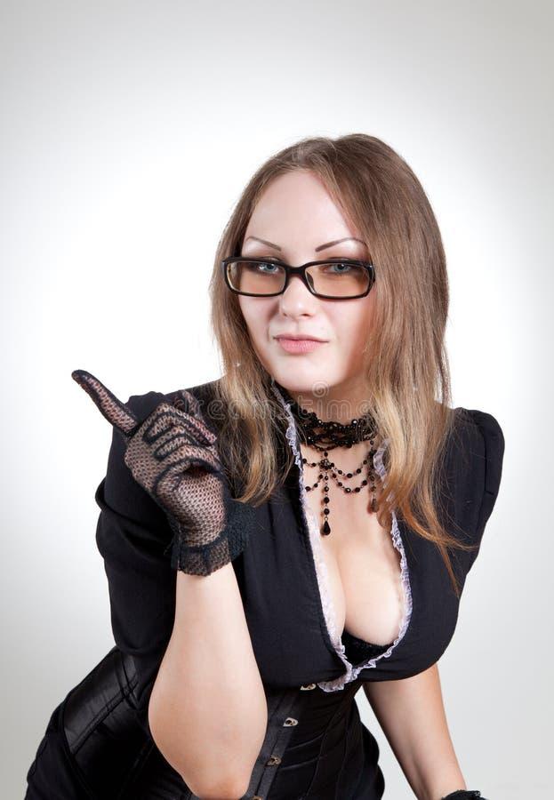 Professor 'sexy' no vestido e no espartilho pretos imagem de stock royalty free