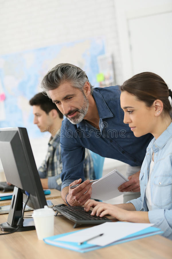 Professor With Student Working On Desktop Computer Stock Photo ...