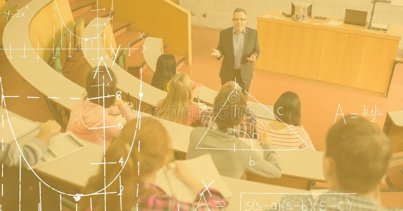 Professor teaching students with diagrams in foreground stock photography