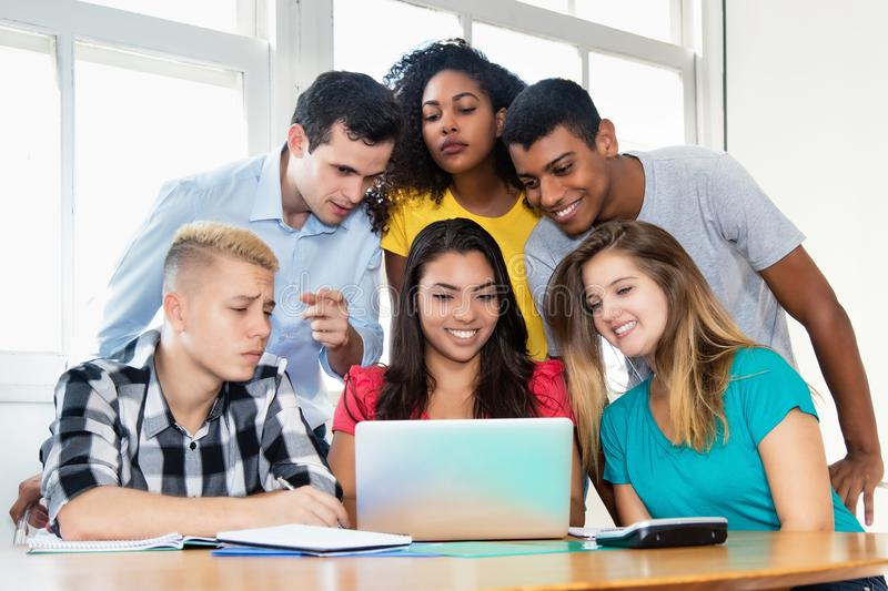 Professor teaching web design with group of students. At classroom of university royalty free stock photos