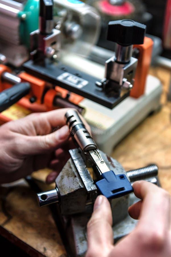Locksmith master repairs door lock cylinder royalty free stock photo