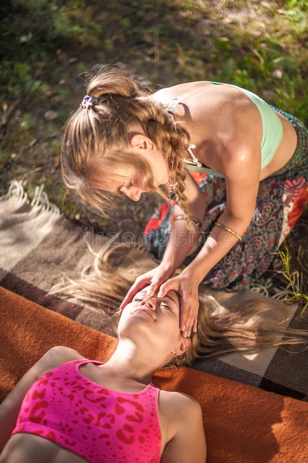 Proffesional masseuse adequately performs a great massage in nature. stock photos