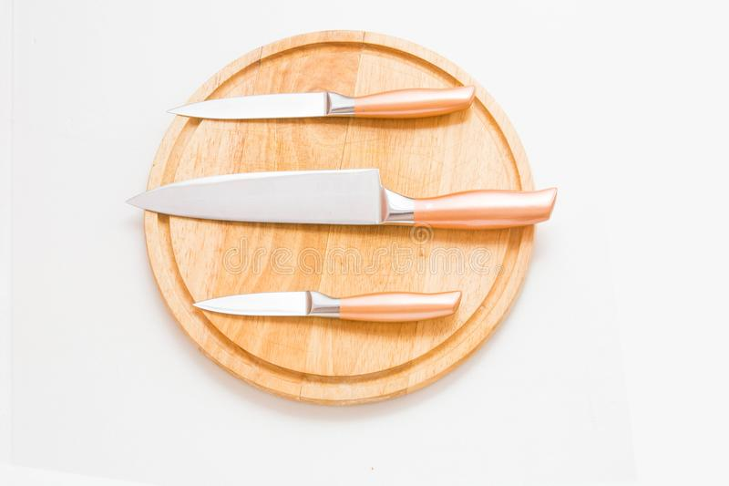 Proffessional chef knifes on the cutting table. stock photo