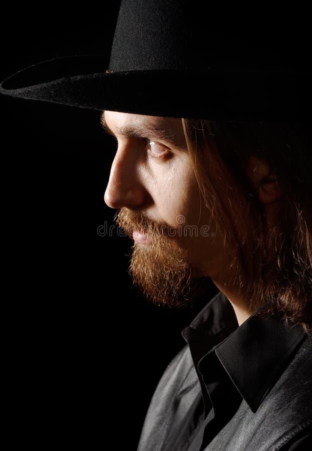 Profiel van de mens in hoed stock fotografie