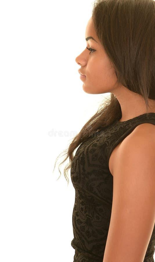 Profiel van ernstig tienermeisje stock fotografie