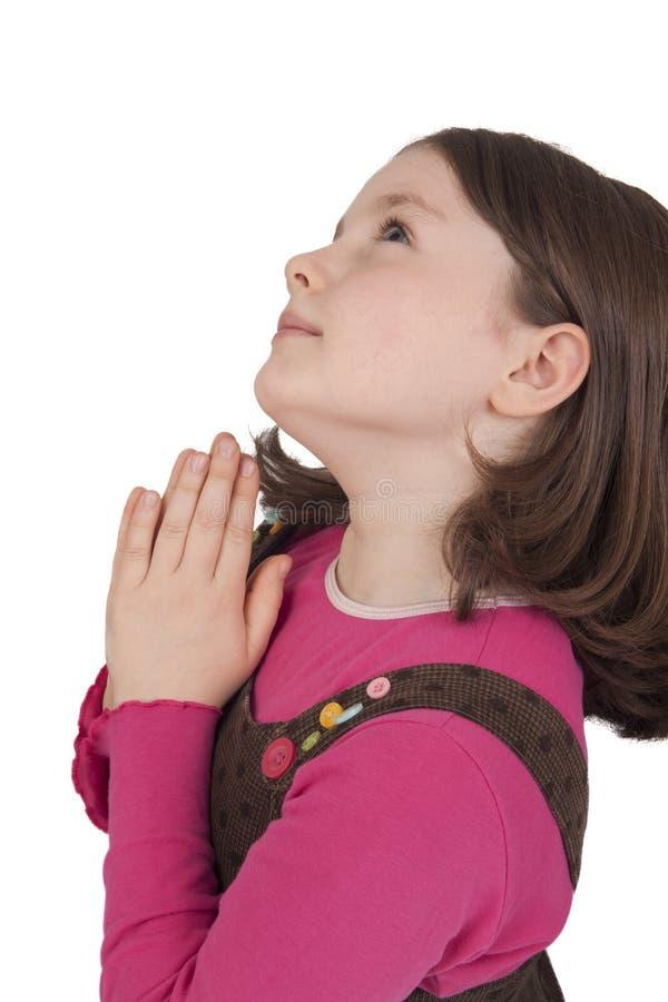 Profiel van het mooie meisje omhoog bidden en het kijken stock fotografie