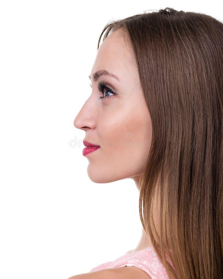 Profiel zijportret van mooie jonge die vrouw, over wit wordt geïsoleerd royalty-vrije stock afbeeldingen