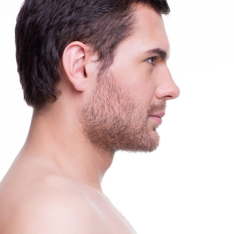 Profielportret van de knappe jonge mens stock foto