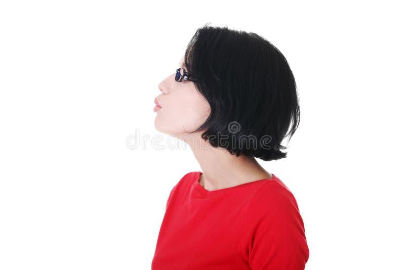Profil av den attraktiva kvinnan i glasögon. royaltyfri fotografi