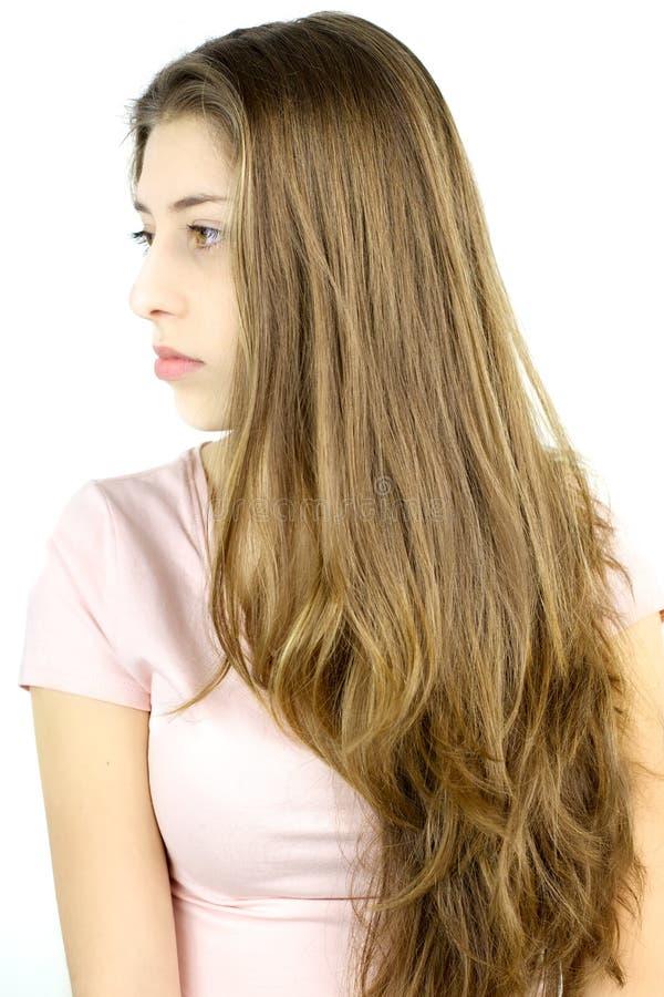 Profil av flickan med mycket långt blont hår royaltyfri fotografi