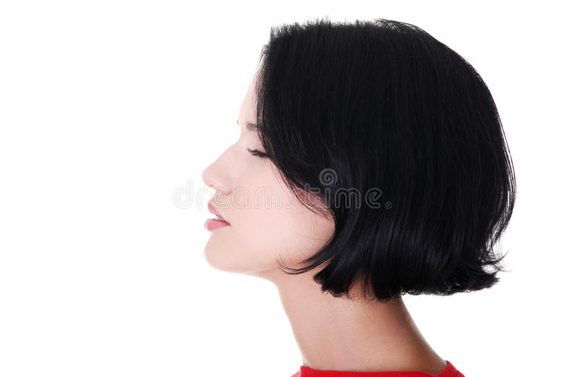 Profil d'une femme avec les yeux fermés. Vue de côté. photos libres de droits