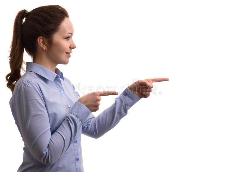 Profil d'une femme de sourire dirigeant le doigt images stock