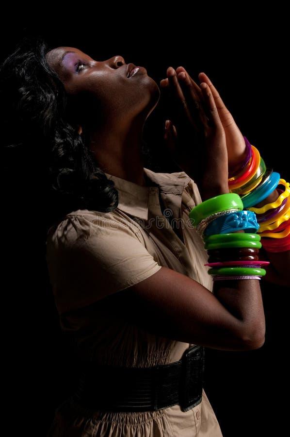 Profil de prière de femme images stock