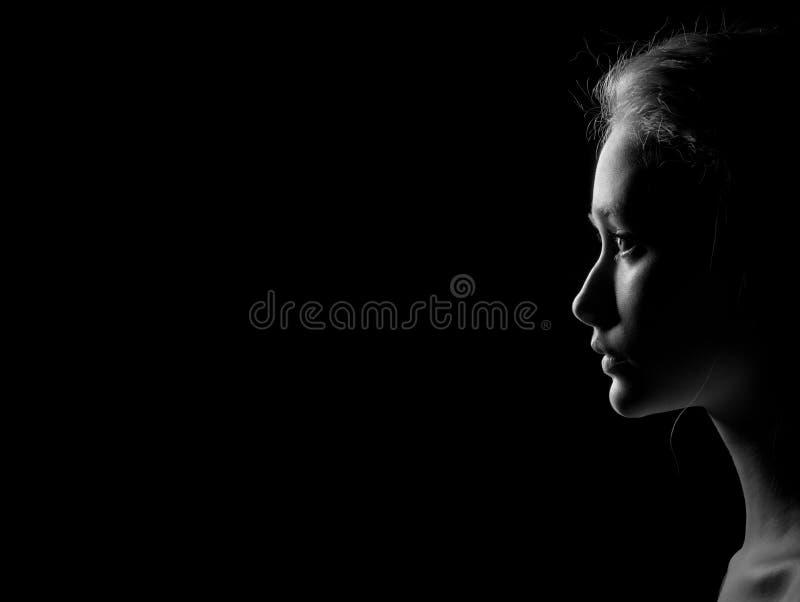 Profil der traurigen Frau lizenzfreie stockbilder