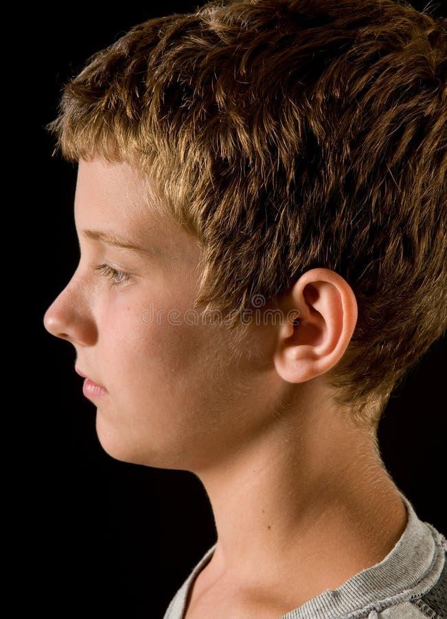 Profil, garçon de la préadolescence beau photo stock