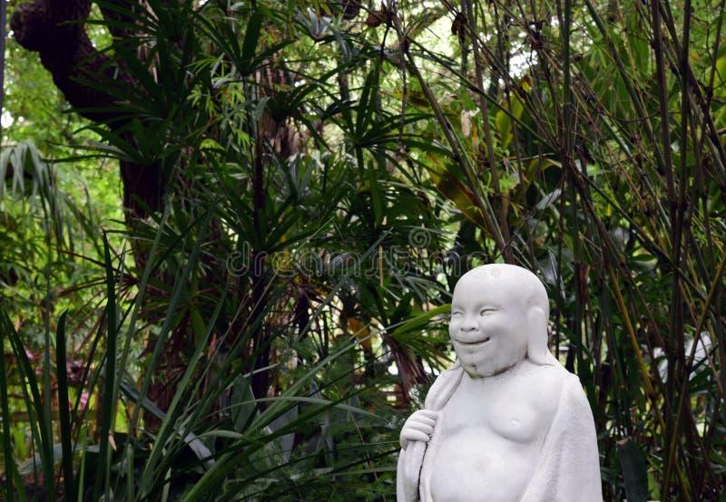 Profil Szczęśliwy Buddha w azjata ogródzie obrazy royalty free
