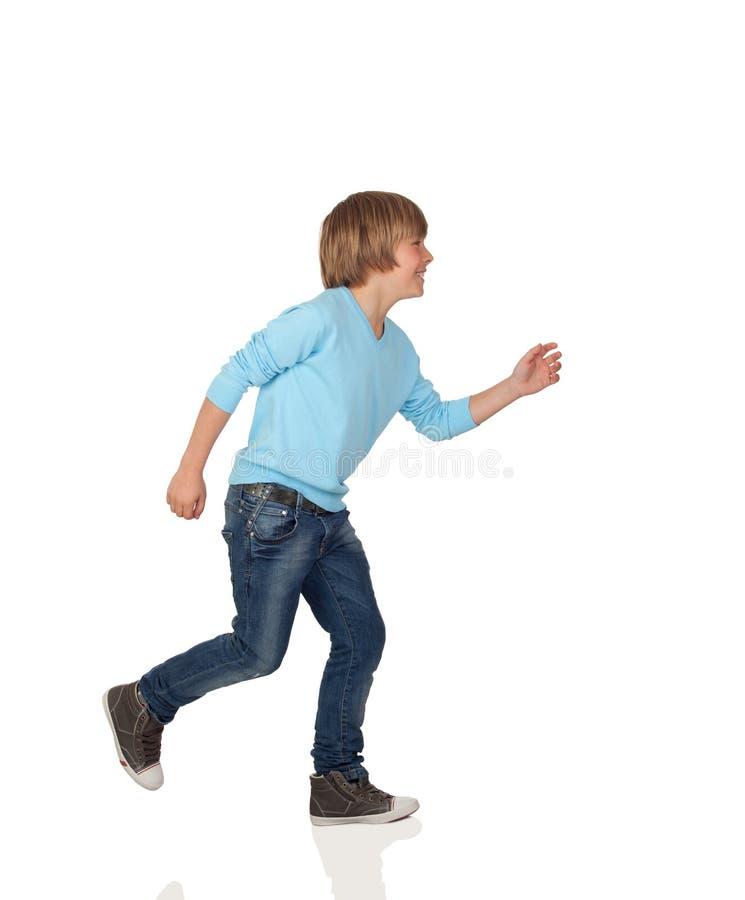 Profile of adorable preteen boy walking stock photo
