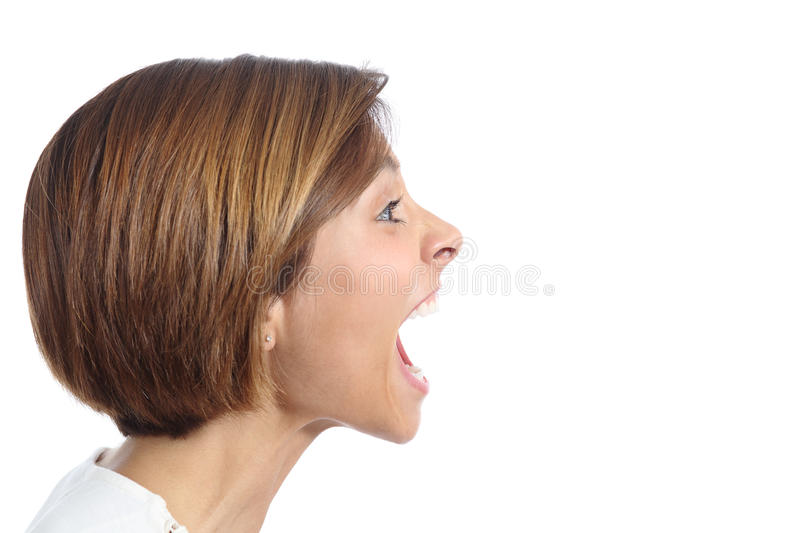 Profile of an angry young woman shouting. Isolated on a white background royalty free stock photography
