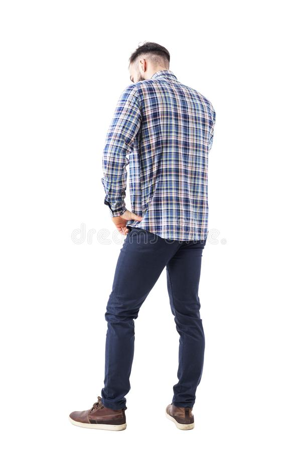 Free Profile Back View Of Caucasian Business Man Talking On The Phone Looking Down With Hand On Hip. Stock Photos - 117708993
