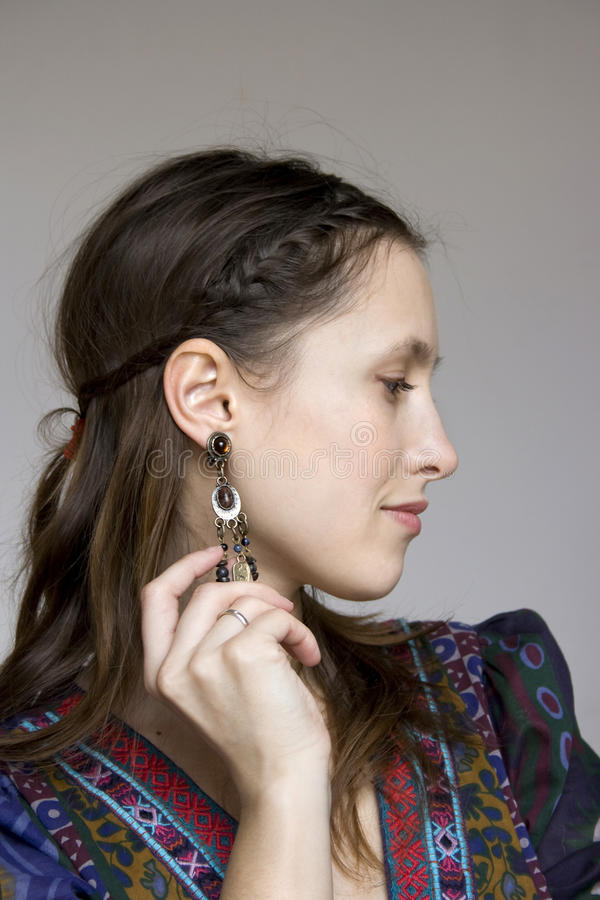 Profile of a beautiful girl in bohemian dress stock image