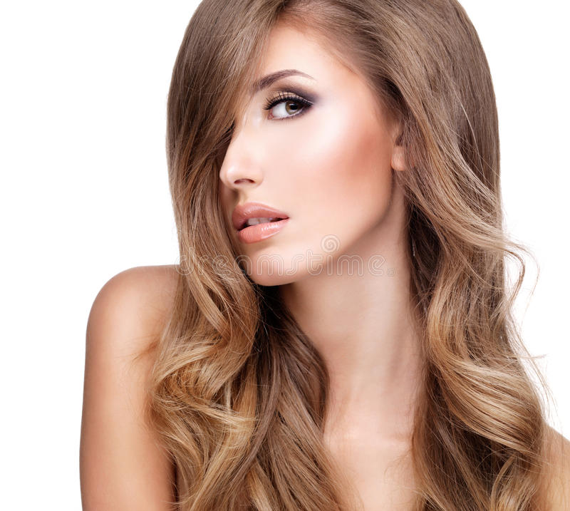Profile of a beautiful woman with long wavy hair royalty free stock images