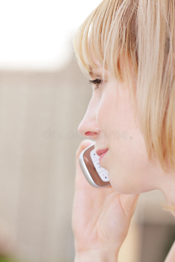 Download Profile Of Blonde With Mobile Stock Photo - Image: 11980544