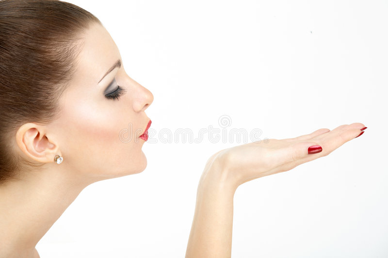 Profile of the blowing woman. Profile of the beauty who is blowing off from a hand, blindly, the isolated stock photo