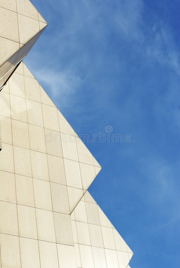 Profile of business office building. Detail of office building with blue sky stock photo