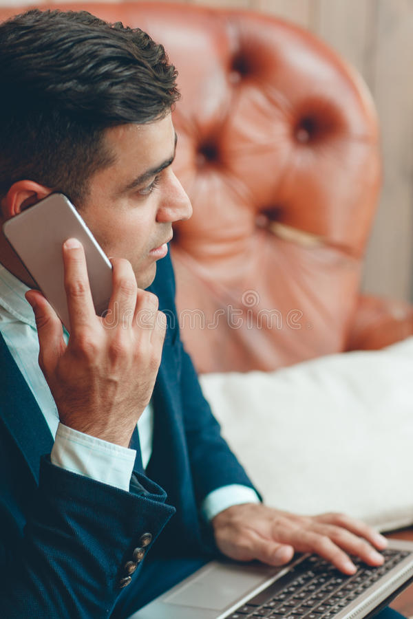 Profile of businessman speaking on phone stock images