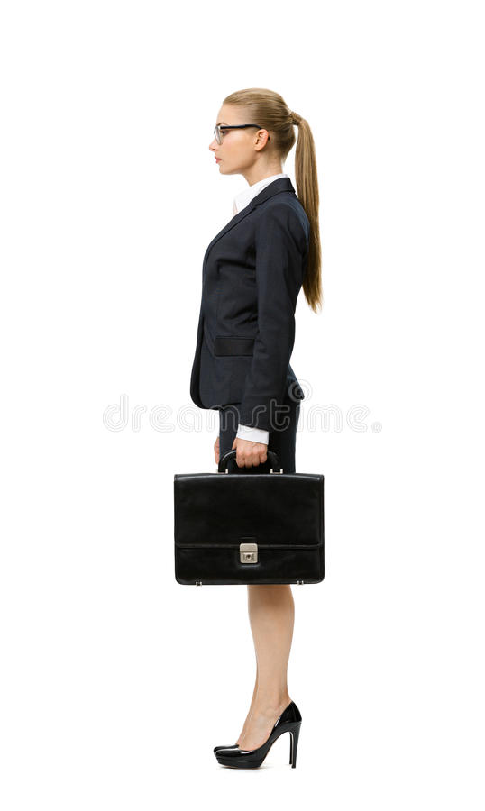 Profile of businesswoman with case royalty free stock image