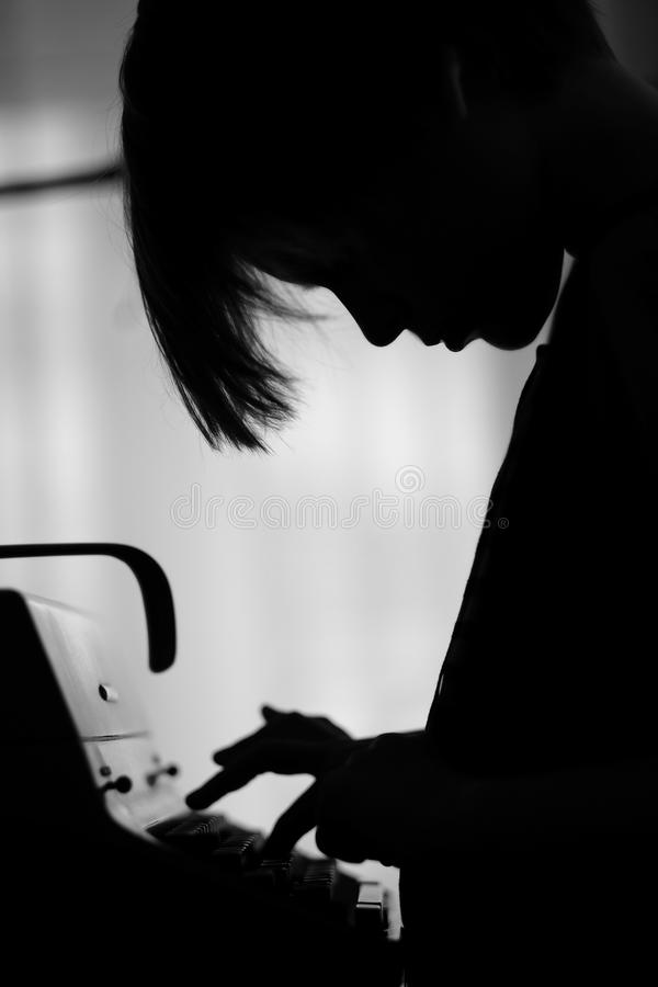 Profile of a child typing on an typewriter stock photos