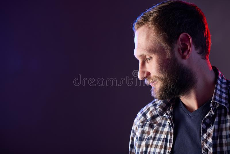 Bearded man looking down royalty free stock photos