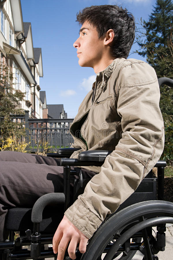 Profile of a disabled teenage boy royalty free stock image
