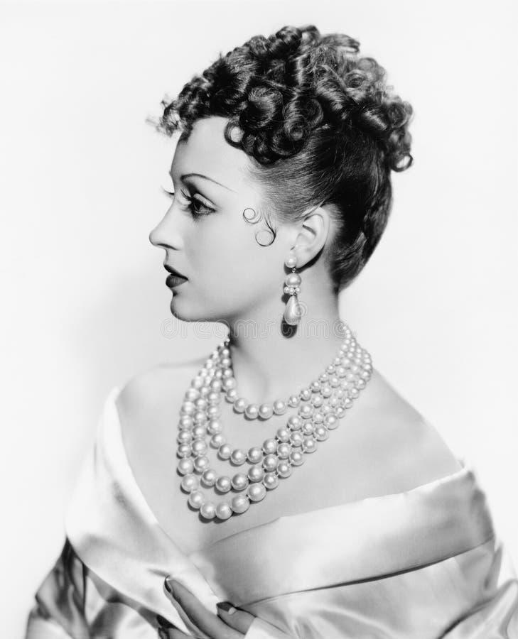 Profile of an elegant woman stock photo