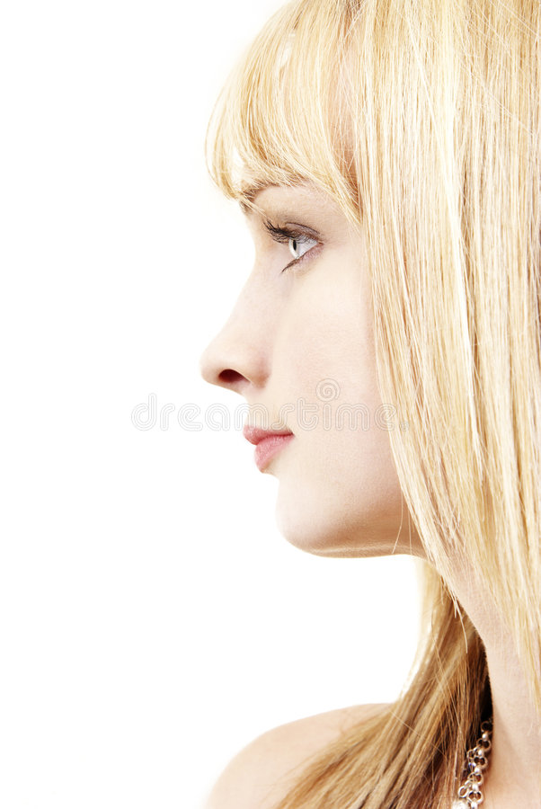 Profile of the face of a beautiful blonde woman royalty free stock image