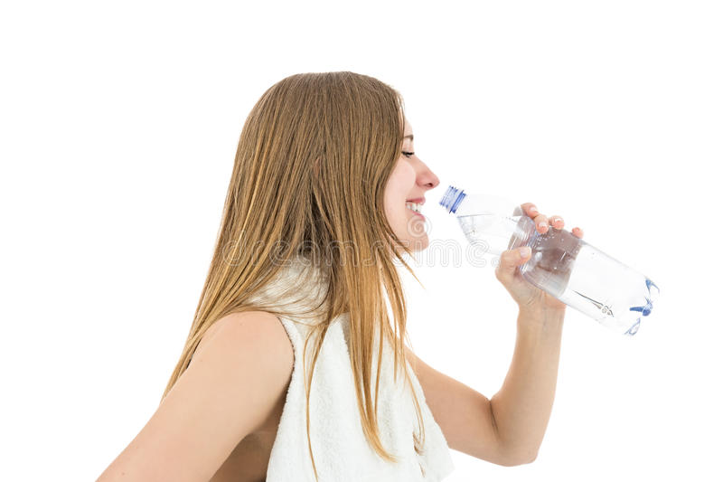 Profile of fitness woman drinking water royalty free stock photo