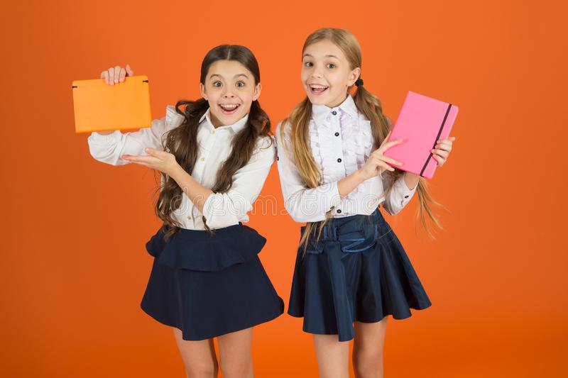 Profile for friends notepad. Dear diary. School stationery. Girls cute kids school uniform orange background. Schoolgirl royalty free stock photos