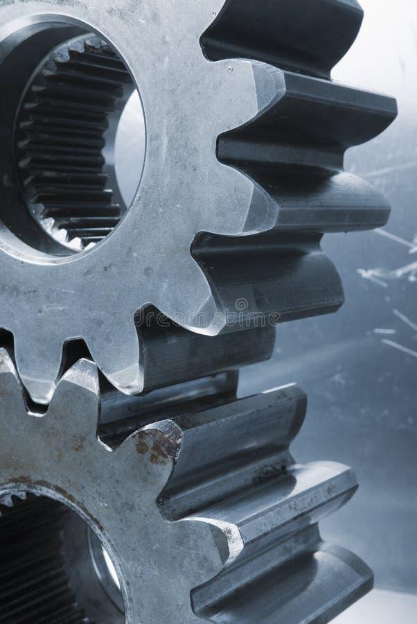 Profile of gears against aluminum stock image