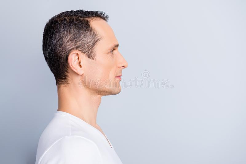 Profile, half face portrait with copy space of trendy, attractive, stylish, man looking at empty place for advertisement, product royalty free stock photography
