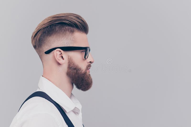 Profile half-faced side view portrait of serious confident concentrated attractive manager with blonde hair wearing rimmed royalty free stock image