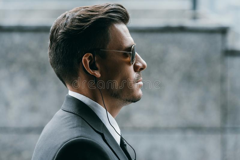 profile of handsome bodyguard with sunglasses royalty free stock photo