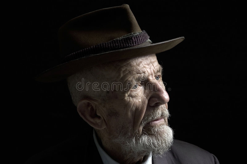 Profile with hat stock photos