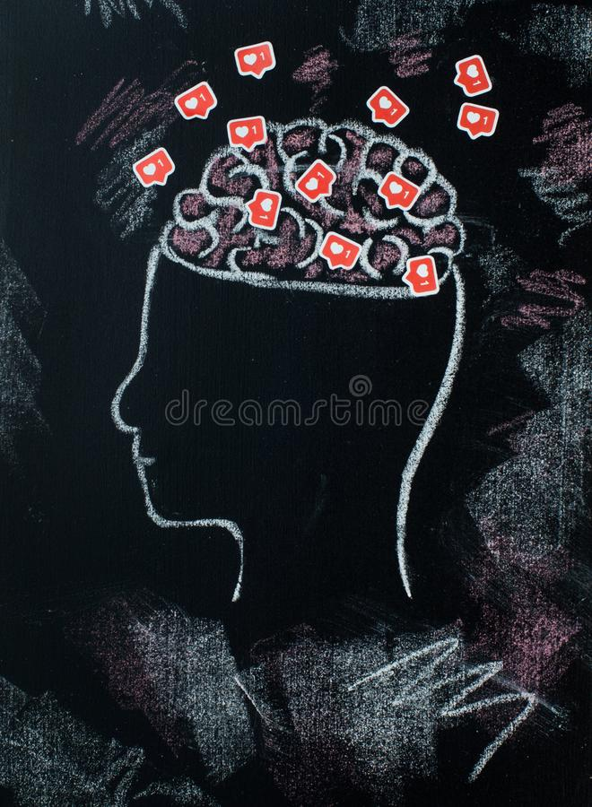 Profile of head with open brains full of likes symboles stock image