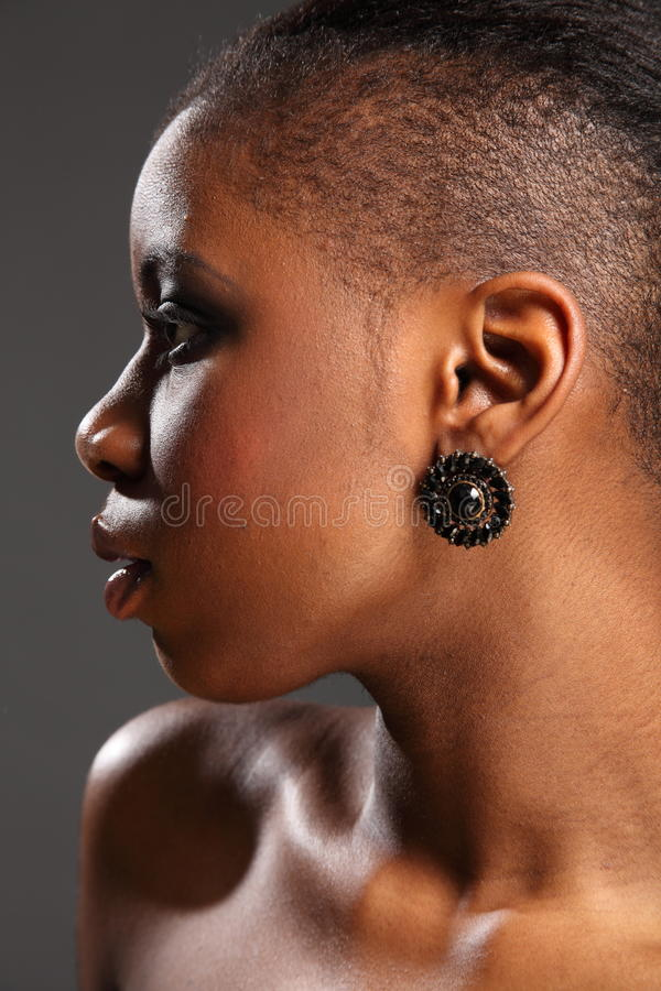 Profile headshot of beautiful black african woman royalty free stock images