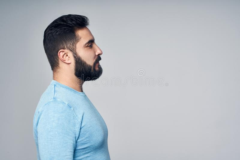 Profile of Hispanic man in casual clothes royalty free stock image